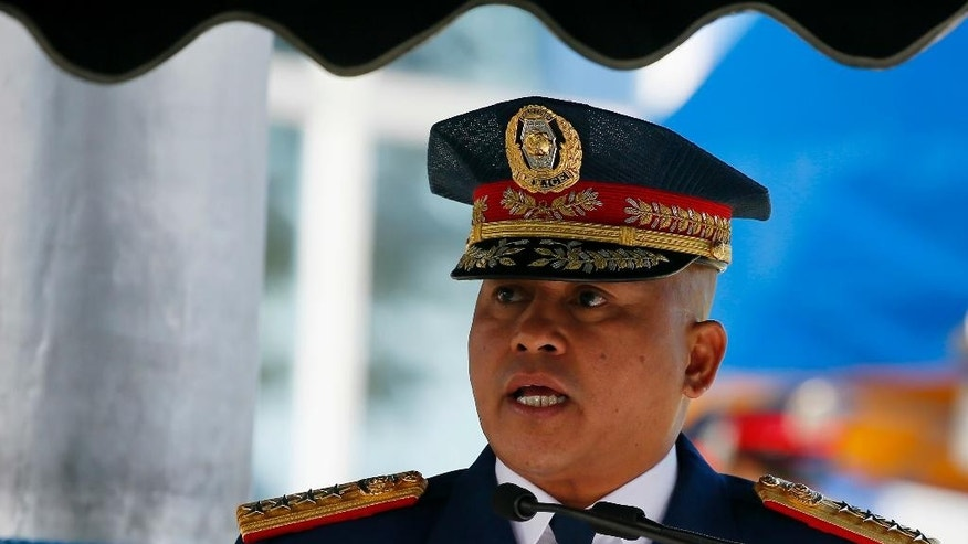 "Philippine National Police Chief Director General Ronald ""Bato"" Dela Rosa addresses the police force to mark its 26th Foundation at the PNP General Headquarters in suburban Quezon city northeast of Manila, Philippines Monday, Feb. 6, 2017. The anniversary celebration was marred by the controversial killing last Oct. 18, 2016 of kidnapped South Korean businessman Jee Ick-joo inside the PNP headquarters by active police officers that prompted the police chief to conduct ""internal cleansing"" among their ranks.(AP Photo/Bullit Marquez)"
