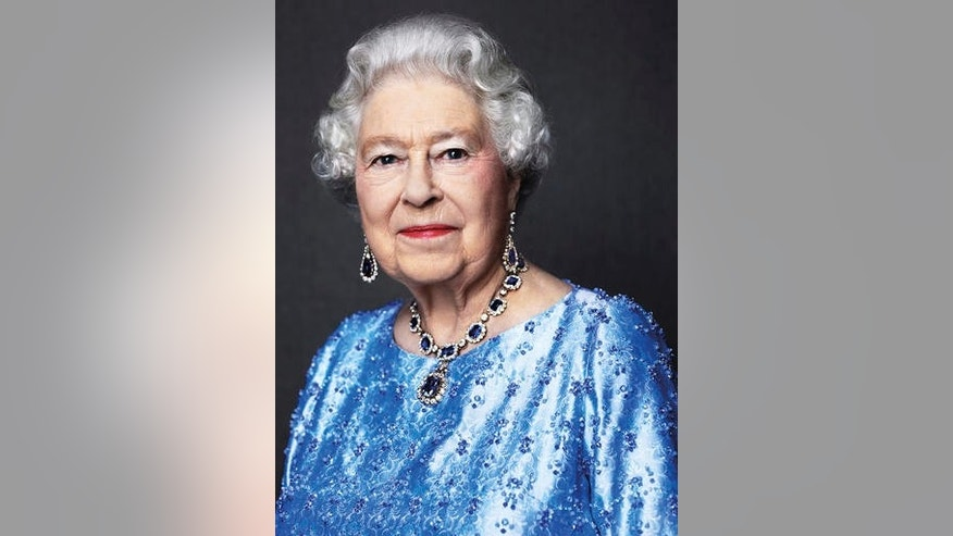 Britain's Queen Elizabeth II wearing sapphire jewelry in 2014.