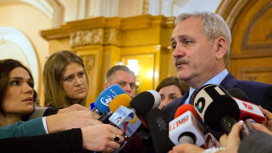 Social Democratic Party leader Liviu Dragnea, whose path to becoming prime minister is effectively blocked by corruption charges, talks to the media in Bucharest, Romania, Monday, Feb. 6, 2017. The largest anti-government crowds since the violent 1989 revolution that toppled dictator Nicolae Ceausescu succeed in pressuring Romania's new government to repeal a hastily adopted decree that would have eased penalties for official corruption. (AP Photo/Darko Bandic)