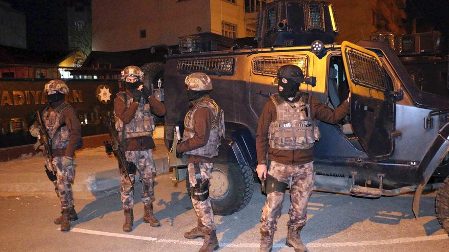 Feb. 5, 2017: Turkish anti-terrorism police stand by their armoured vehicle during an operation to arrest people over alleged links to the Islamic State group, in Adiyaman, southeastern Turkey.