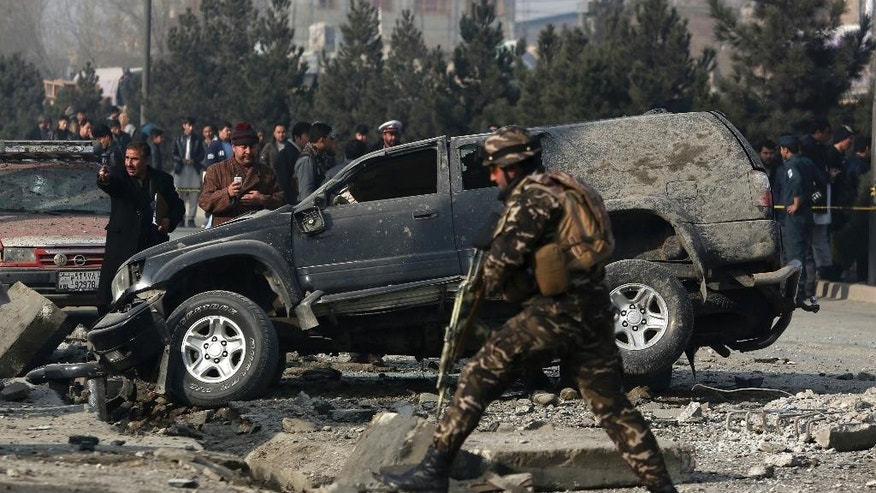 FILE - In this Wednesday, Dec. 28, 2016, file photo, Afghan security personnel inspect the site of roadside bomb blast in Kabul, Afghanistan. The U.N. mission in Afghanistan says the number of civilian casualties in the country's conflict rose by 3 percent in 2016. The U.N. 2016 Annual Report on the Protection of Civilians in Armed Conflict in Afghanistan was released Monday, Feb. 6, 2017. (AP Photo/Rahmat Gul, File)