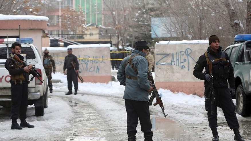 Security personnel stand guard at the site of a suicide attack on the Supreme Court in Kabul, Afghanistan, Tuesday, Feb. 7, 2017. An official says a suicide bomber has struck near the Supreme Court building in Kabil, killing several people. (AP Photos/Massoud Hossaini)