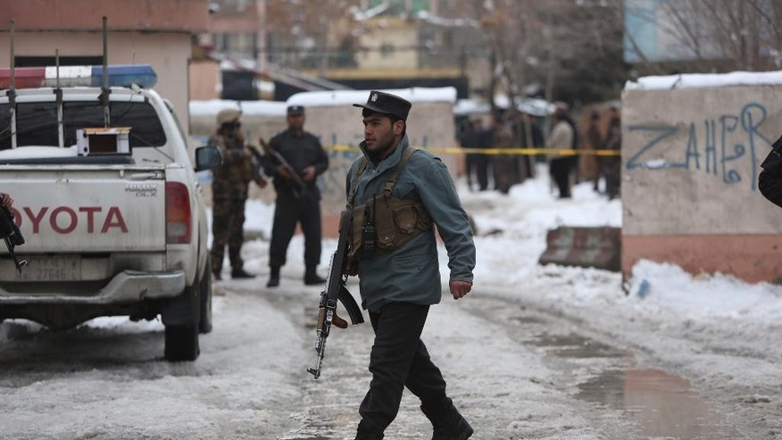 Police officers inspect the site of suicide attack in Kabul, Afghanistan, Tuesday, Feb. 7, 2017. (AP Photo/Rahmat Gul)