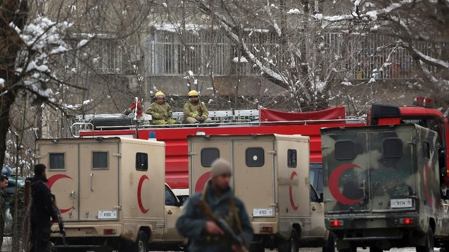 Security forces stand guard at the site of a a suicide attack on the Supreme Court in Kabul, Afghanistan, Tuesday, Feb. 7, 2017. An official says a suicide bomber has struck near the Supreme Court building in Kabul, killing several people. (AP Photos/Massoud Hossaini)