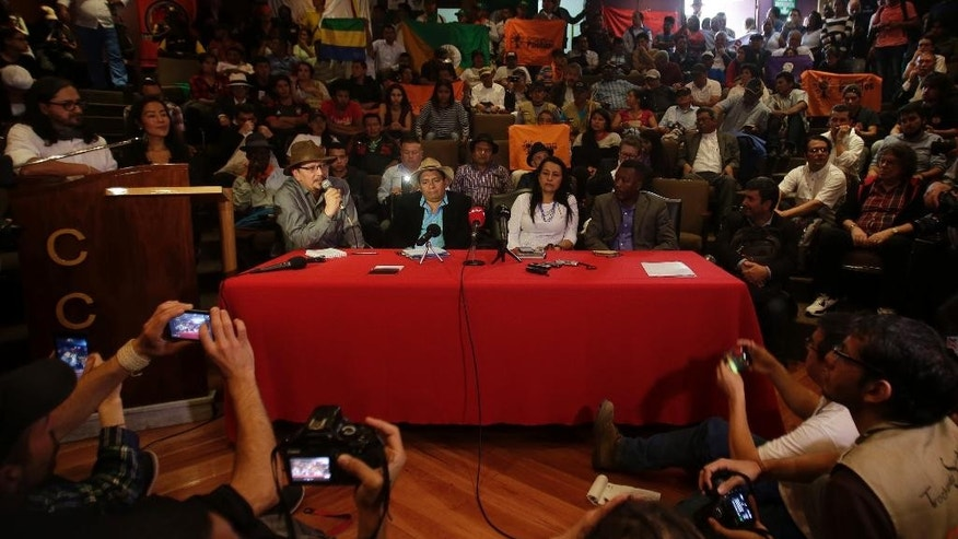 Delegates from Colombian social movements give a press conference in support the peace talks between The National Liberation Army (ELN) and Colombia's government, starting today in Quito, Ecuador, Tuesday, Feb. 7, 2017. (AP Photo/Dolores Ochoa)