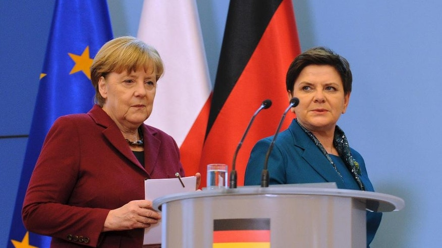 German Chancellor Angela Merkel, left, and Poland's Prime Minister Beata Szydlo arrive for a press conference in Warsaw, Poland, Tuesday, Feb. 7, 2017, when Merkel visits Poland for talks with several top leaders. (AP Photo/Alik Keplicz)