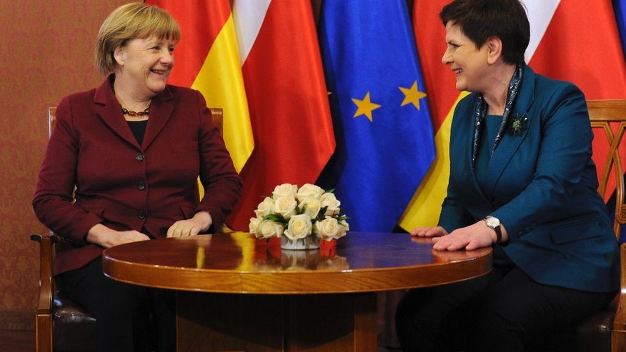 German Chancellor Angela Merkel, left, talks with Poland's Prime Minister Beata Szydlo in Warsaw, Poland, Tuesday, Feb. 7, 2017, when Merkel visits Poland for talks with several top leaders. (AP Photo/Alik Keplicz)