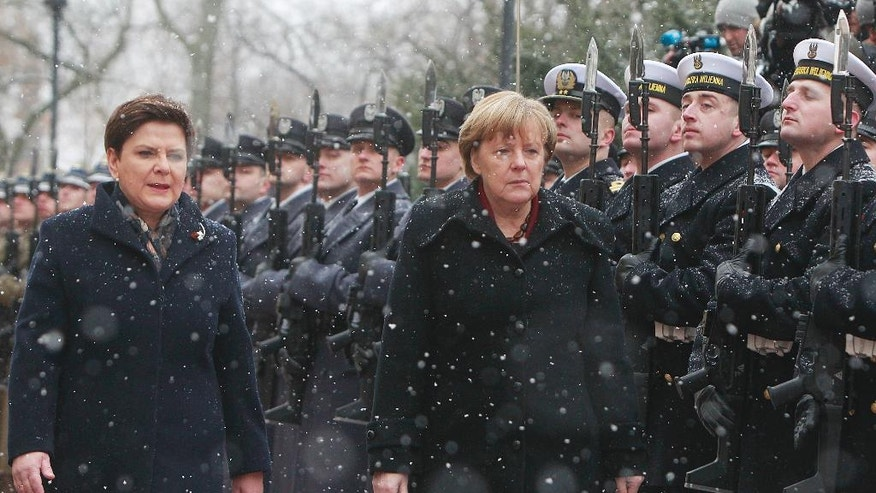 German Chancellor Angela Merkel, right, is welcomed by Poland's Prime Minister Beata Szydlo in Warsaw, Poland, Tuesday, Feb. 7, 2017, when Merkel visits Poland for talks with several top leaders. (AP Photo/Czarek Sokolowski)