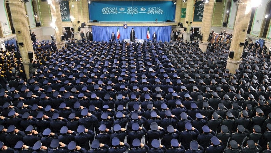 "In this picture released by an official website of the office of the Iranian supreme leader, Supreme Leader Ayatollah Ali Khamenei stands as air force commanders salute during their meeting in Tehran, Iran, Tuesday, Feb. 7, 2017. Iran's supreme leader said Tuesday that ""newcomer"" President Donald Trump had shown the ""real face"" of the United States, after the American leader accused Iran of being ungrateful for sanctions relief approved by the Obama administration and vowed a tougher stance. Verses from the Islamic holy book, the Quran, are seen behind Khamenei. (Office of the Iranian Supreme Leader via AP)"