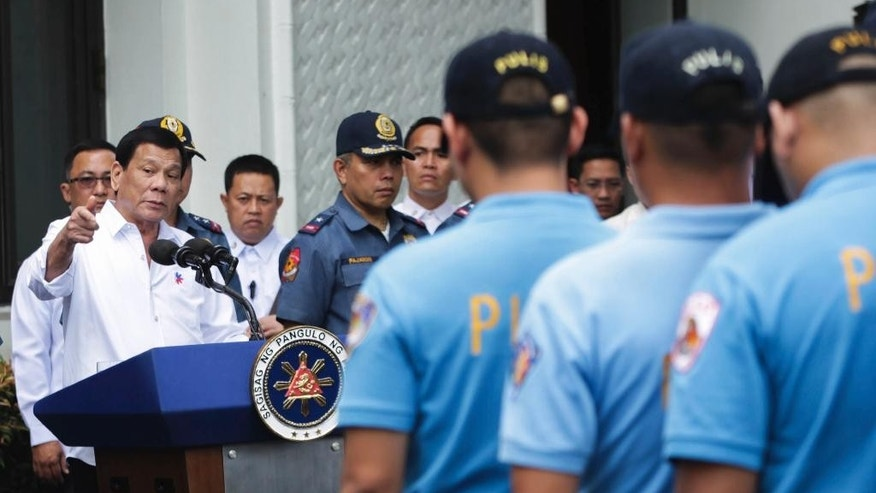 "In this photo provided by the Presidential Photographers Division, Malacanang Palace, Philippine President Rodrigo Duterte, left, berates erring policemen during an audience at the Presidential Palace grounds in Manila, Philippines, Tuesday, Feb. 9, 2017. Duterte angrily berated more than 200 allegedly erring policemen and said he would send them to a southern island to fight extremists dreaded for their beheadings. Duterte's expletive-filled outburst against the officers at the palace was his latest tirade against a police force that he has called ""rotten to the core."" He recently banned the national police from carrying out his anti-drug campaign after a group of officers used the crackdown as a cover to kidnap and kill a South Korean man in an extortion scandal. (Robinson Ninal/Presidential Photographers Division, Malacanang Palace via AP)"