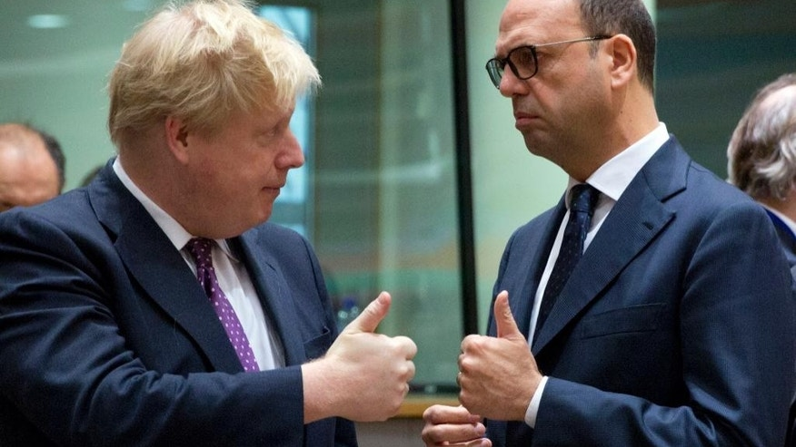 British Foreign Minister Boris Johnson, left, speaks with Italian Foreign Minister Angelino Alfano during a meeting of EU foreign ministers at the EU Council building on Monday, Feb. 6, 2017. (AP Photo/Virginia Mayo)