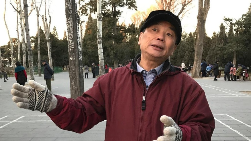 "In this Dec. 22, 2016 photo, Cai Fujian speaks during an interview as he visits the Temple of Heaven with friends in Beijing. When the smog descends over northern China, turning blue skies gray and thickening the air, 65-year-old Cai can feel his lungs tightening. He begins to cough. For weeks at a time, China's smog transforms cities across the industrial north into quiet, gray shells of their normal selves. The Associated Press visited several spots in Beijing in late December during and after a smog ""red alert,"" and used a 360-degree camera to record the difference at each location. (AP Photo/Nomaan Merchant)"
