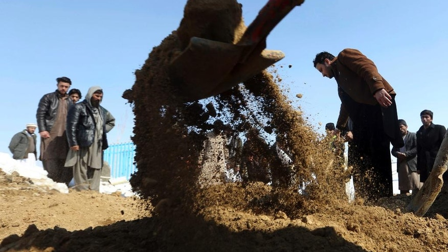 Men bury a victim of a suicide attack on the Supreme Court in Kabul, Afghanistan, Wednesday, Feb. 8, 2017. A suicide bomber on Tuesday targeted the Supreme Court building in the Afghan capital, Kabul, killing at least 19 people. (AP Photo/Rahmat Gul)