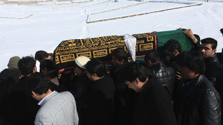 Men carry the coffin of a relative who died in a suicide attack on the Supreme Court in Kabul, Afghanistan, Wednesday, Feb. 8, 2017. A suicide bomber on Tuesday targeted the Supreme Court building in the Afghan capital, Kabul, killing at least 19 people. (AP Photo/Rahmat Gul)