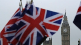 Union flags displayed on a tourist stall, backdropped by the Houses of Parliament and Elizabeth Tower containing the bell know as Big Ben, in London, Wednesday, Feb. 8, 2017. Britain's House of Commons is set to approve a bill authorizing the start of exit talks with the European Union — a major step on the road to Brexit. The bill sailed through an earlier vote last week 498-114 and is very likely to pass its final Commons test Wednesday evening. (AP Photo/Matt Dunham)