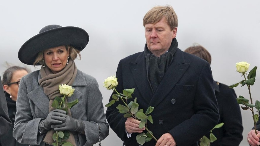 King Willem-Alexander, right,  and Queen Maxima of the Netherlands visit the memorial of former Nazi concentration camp Buchenwald, near Weimar, Germany, Wednesday Feb. 8, 2017.   ( Jan Woitas/dpa via AP)