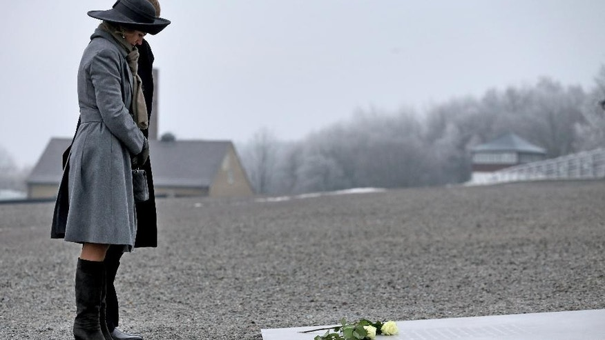 King Willem-Alexander,  behind, and Queen Maxima of the Netherlands  have placed flowers at  the memorial of former Nazi concentration camp Buchenwald, near Weimar, Germany, during their visit on Wednesday Feb. 8, 2017.   ( Jan Woitas/dpa via AP)