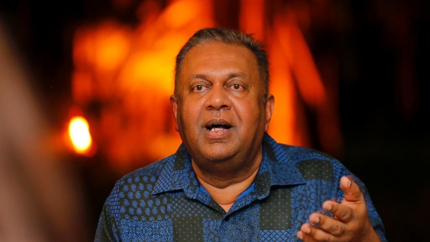 In this Tuesday, Feb. 7, 2017 photo, Sri Lankan Foreign Minister Mangala Samaraweera gestures as he speaks to foreign correspondants at his residence in Colombo, Sri Lanka. Sri Lanka says it needs more time to fulfill promises given to the U.N. human rights body to investigate war crime allegations from the nation's long civil war, which ended nearly eight years ago. Samaraweera told foreign correspondents late Tuesday that the government will seek more time at the next U.N. human rights session, starting Feb. 27 in Geneva. (AP Photo/Eranga Jayawardena)