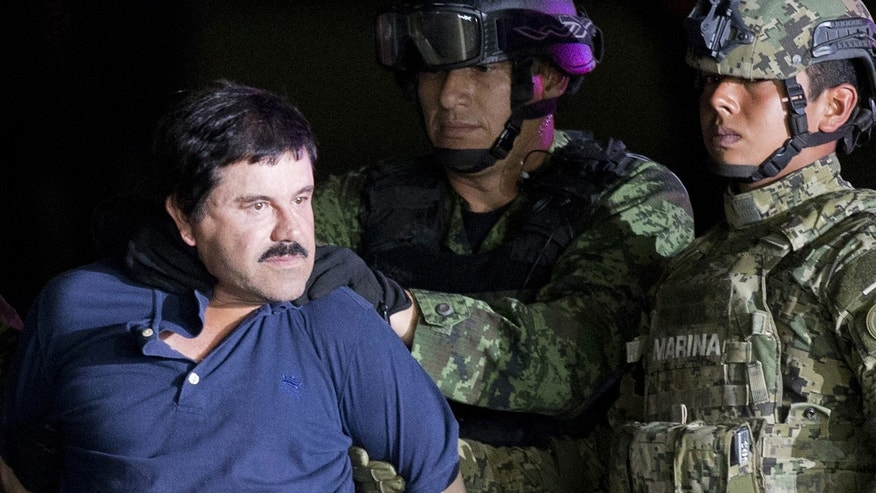 "FILE - In this Jan. 8, 2016 file photo, a handcuffed Joaquin ""El Chapo"" Guzman is made to face the press as he is escorted to a helicopter by Mexican soldiers and marines at a federal hangar in Mexico City."