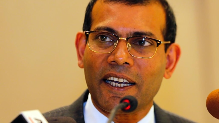 Maldives' former president Mohamed Nasheed speaks during a press conference in Colombo, Sri Lanka, Thursday, Feb. 9, 2017. The former leader, who is living in exile in London, says he plans to contest next year's presidential election in his country despite an outstanding prison sentence. Nasheed, who is currently visiting Sri Lanka, received a 13-year jail term and was imprisoned in 2015 for ordering the arrest of a senior judge while in office. (AP Photo/Eranga Jayawardena)