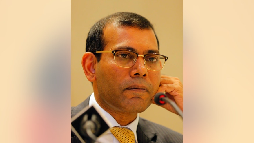 Maldives' former president Mohamed Nasheed takes a question from a journalist during a press conference in Colombo, Sri Lanka, Thursday, Feb. 9, 2017. The former leader, who is living in exile in London, says he plans to contest next year's presidential election in his country despite an outstanding prison sentence. Nasheed, who is currently visiting Sri Lanka, received a 13-year jail term and was imprisoned in 2015 for ordering the arrest of a senior judge while in office. (AP Photo/Eranga Jayawardena)