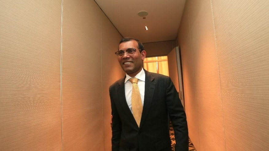 Maldives' former president Mohamed Nasheed leaves after addressing a press conference in Colombo, Sri Lanka, Thursday, Feb. 9, 2017. The former leader, who is living in exile in London, says he plans to contest next year's presidential election in his country despite an outstanding prison sentence. Nasheed, who is currently visiting Sri Lanka, received a 13-year jail term and was imprisoned in 2015 for ordering the arrest of a senior judge while in office. (AP Photo/Eranga Jayawardena)