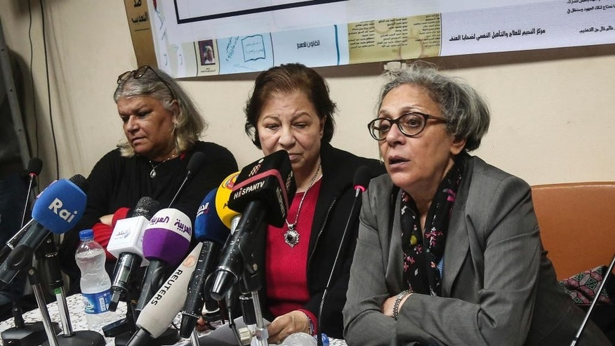 FILE - In this Feb. 21, 2016 file photo, Aida Seif el-Dawla, Suzan Fayyad, center, and Magda Adly, right, co-founder of El Nadeem Center for Rehabilitation of Victims of Violence, hold a press conference in Cairo. The founder of the Egyptian center that treats victims of torture and trauma said Thursday, Feb. 9, 2017, that the institution has been closed down by police. El-Dawla told The Associated Press that when staff arrived at the center on Thursday the facility had been sealed off by police and the building's doorman taken into custody for questioning. (AP Photo/Mohamed el Raai, File)