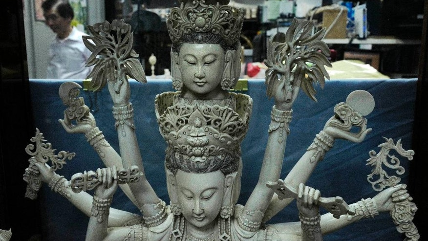 In this Jan. 13, 2017 photo, an ivory sculpture of the Chinese goddess Guanyin is displayed at Lise Carving and Jewellrey workshop in Hong Kong. The decline of the city's once-flourishing ivory business is set to accelerate further after the Hong Kong and mainland Chinese governments unveiled plans in December to restrict local ivory trading. Wildlife activists hailed the news, saying that phasing out domestic markets is a key step in reducing demand for tusks fueling the illegal poaching decimating Africa's elephants. (AP Photo/Vincent Yu)