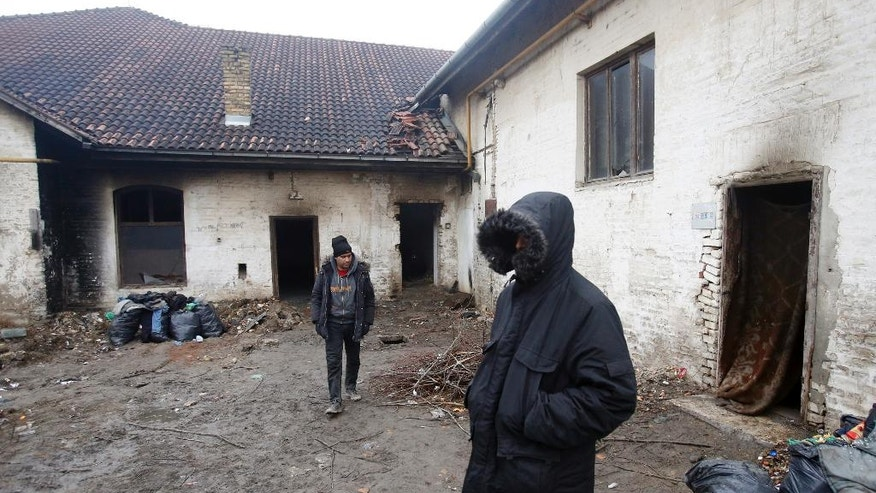 Migrants walk by an abandoned brick factory in the northern Serbian town of Subotica, near the border between Serbia and Hungary, Wednesday, Feb. 8, 2017. European Union countries have only taken in around 12,000 refugees from overburdened Greece and Italy despite promising to share 160,000 almost 18 months ago. (AP Photo/Darko Vojinovic)