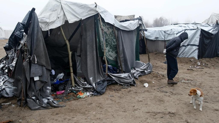 A migrant walks through the makeshift refugee camp near the Horgos border crossing into the Hungary, near Horgos, Serbia, Wednesday, Feb. 8, 2017. European Union countries have only taken in around 12,000 refugees from overburdened Greece and Italy despite promising to share 160,000 almost 18 months ago. (AP Photo/Darko Vojinovic)