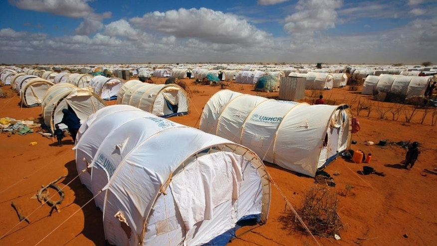 FILE - In this Friday, Aug. 5, 2011, file photo, tents are seen at the UNHCR's Ifo Extension camp outside Dadaab, eastern Kenya, 100 kilometers (62 miles) from the Somali border. A Kenyan court on Thursday, Feb. 9, 2017 declared illegal a government order to close the world's largest refugee camp and send more than 200,000 people back to war-torn Somalia. (AP Photo/Jerome Delay, File)