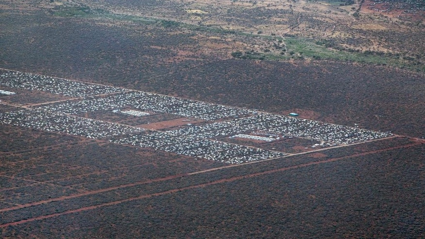 FILE - In this Monday, Feb. 20, 2012, file photo, parts of Dadaab, the world's largest refugee camp, are seen from a helicopter in northern Kenya. A Kenyan court on Thursday, Feb. 9, 2017 declared illegal a government order to close the world's largest refugee camp and send more than 200,000 people back to war-torn Somalia. (AP Photo/Ben Curtis, File)