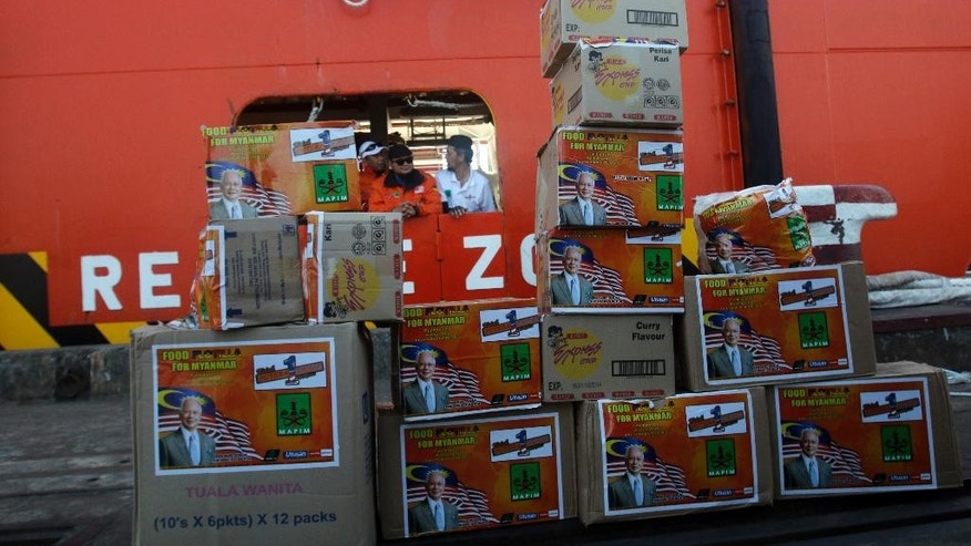 "Boxes with images of Malaysian Prime Minister Najib Razak containing aid for Rohingya are piled up on a Malaysian ship upon arrival at Thilawa port in Yangon, Myanmar, Thursday, Feb. 9, 2017. The ""Food Flotilla for Myanmar"" carrying 2,300 tons of food and medicine to help members of Myanmar's persecuted Muslim Rohingya minority arrived in Yangon as rights groups accuse the army of mass killings, rapes and other crimes targeting the ethnic group. (AP Photo/Thein Zaw)"