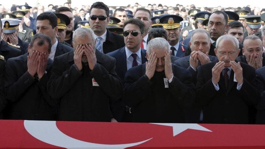 Turkey's political leaders, commanders and family members attend funeral prayers for Mahmut Uslu, one of five Turkish soldiers killed in an attack by IS militants around the Syrian town al Bab on Tuesday night, during a ceremony in Ankara, Turkey, Thursday, Feb. 9, 2017. (AP Photo/Burhan Ozbilici)