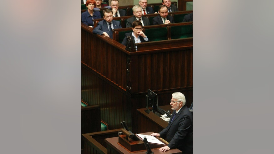 Poland's Foreign Minister Witold Waszczykowski,right,  delivers a speech to stress the need to strengthen the region's security and prevent a further disintegration of the European Union, in parliament in Warsaw, Poland, Thursday, Feb. 9, 2017. (AP Photo/Czarek Sokolowski)