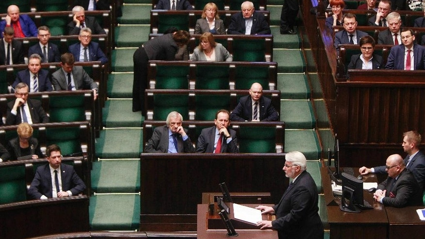 Poland's Foreign Minister Witold Waszczykowski,center bottom , delivers his policy speech to stress the need to strengthen the region's security and prevent a further disintegration of the European Union, in parliament in Warsaw, Poland, Thursday, Feb. 9, 2017.(AP Photo/Czarek Sokolowski)