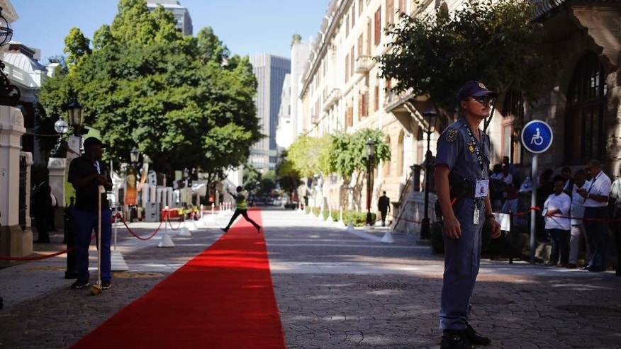 A South African policeman provides security outside parliament in Cape Town, South Africa, Thursday, Feb. 9, 2017. South African police and military forces are deploying ahead of a speech in parliament by President Jacob Zuma, the target of protesters who say he should quit because of corruption allegations. (AP Photo/Schalk van Zuydam)