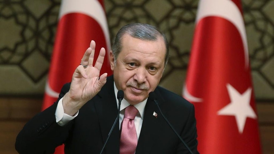 "Turkey's President Recep Tayyip Erdogan gestures as he addresses local administrators, in Ankara, Turkey, Wednesday, Feb. 8, 2017. In a sign of ameliorating ties, Turkish officials said Wednesday that U.S. President Donald Trump looked ""positively"" on two key Turkish demands that had soured relations with the Obama administration, during a telephone conversation with Erdogan. (Yasin Bulbul/Pool photo via AP)"