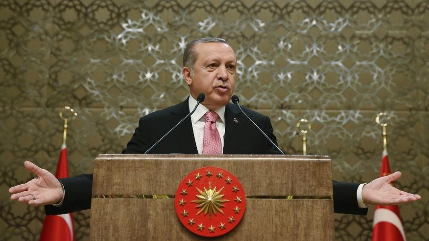Turkey's President Recep Tayyip Erdogan addresses local administrators after the government has sacked nearly 4,500 more state employees, including academicians, as it appeared to press ahead with a purge of people with suspected links to a U.S.-based cleric accused of orchestrating a failed military coup, in Ankara, Turkey, Wednesday, Feb. 8, 2017. (YasinBulbul/Pool photo via AP)