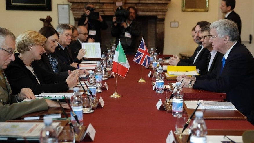 Italian Minister of Defense Roberta Pinotti, second from left, faces British Defense Secretary Sir Michael Fallon, with their respective delegations, during their meeting, in Rome, Thursday, Feb. 9, 2017. (AP Photo/Alessandra Tarantino)