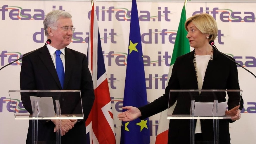 Italian Minister of Defense Roberta Pinotti, right, and British Defense Secretary Sir Michael Fallon make their statements to the press following their meeting, in Rome, Thursday, Feb. 9, 2017. (AP Photo/Alessandra Tarantino)
