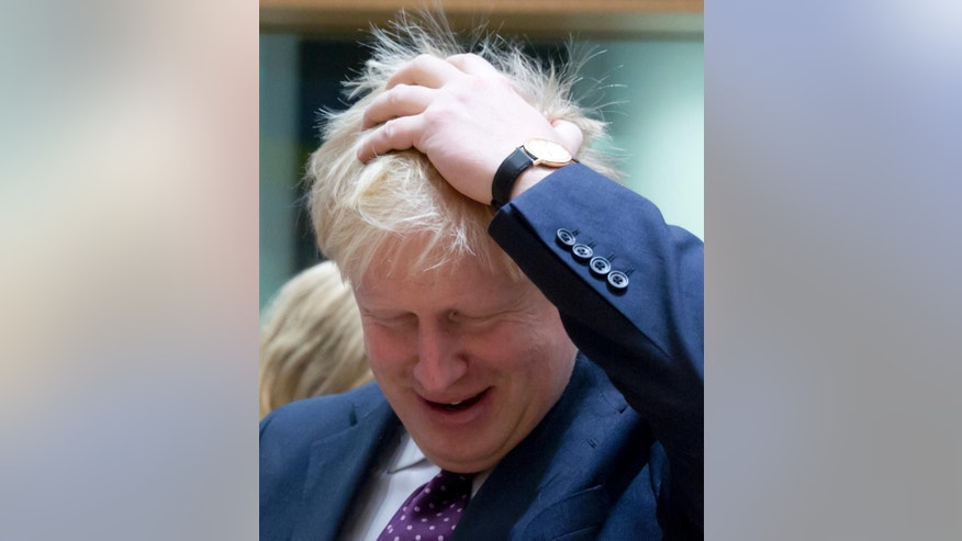British Foreign Minister Boris Johnson arrives for a meeting of EU foreign ministers at the EU Council building on Monday, Feb. 6, 2017. (AP Photo/Virginia Mayo)