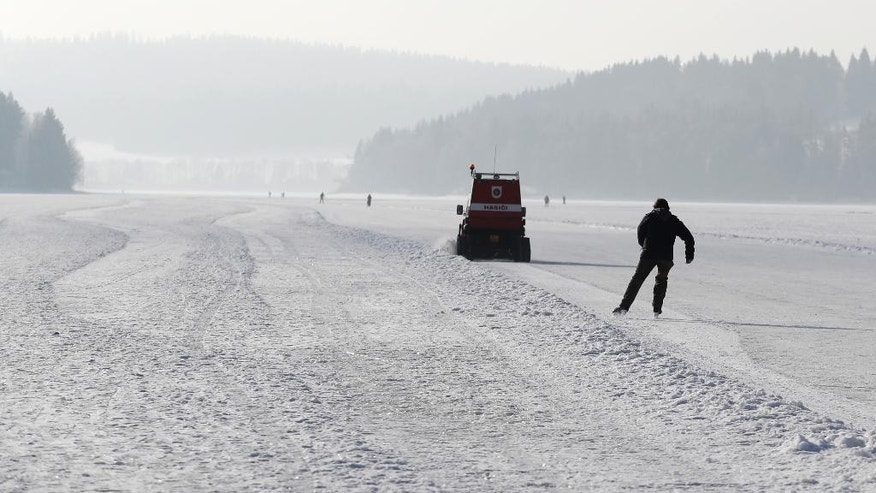 A man skates on a maintained icy track on the vast frozen surface of the Lipno dam near the village of Frymburk, Czech Republic, Friday, Feb. 10, 2017. This year's unusually cold winter has turned a Czech lake resort into a skating heaven. With the ice thick well over the necessary 17 centimeters (6.7 inches) and a long wave of icy condition made it possible to skate on the largest Czech lake for the record three straight weeks. (AP Photo/Petr David Josek)