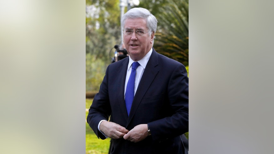 "British Defense Minister Michael Fallon arrives at the presidential palace for a meeting with a Cypriot President Nicos Anastasiades in capital Nicosia, in the eastern Mediterranean island of Cyprus, on Friday, Feb. 10, 2017. Britain's defense secretary says the role played the UK's two military bases on Cyprus are ""more important than ever"" because of the rise of extremist terror and mass migration flows coming from the region. (AP Photo/Petros Karadjias)"