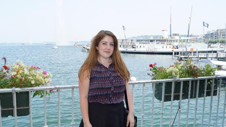In this photo taken in July 2015 provided by her grandfather, Selena Mercado poses for a photograph in front of the Geneva Jet d'Eau landmark on Geneva lake, In Geneva, Switzerland.  High-school student Mercado was born in Switzerland, has gone to school in Switzerland, considers herself Swiss and dreams of a political career here one day. But her passport is from Chile, a country that she's never set foot in but was home to her grandparents before they moved to this small Alpine nation decades ago. (Photo via AP)