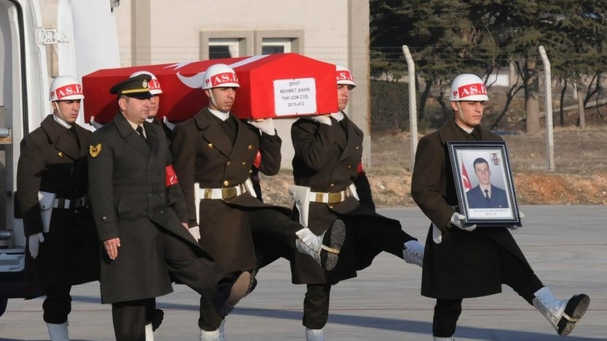 "Turkish soldiers carry the national flag-draped coffin of Mehmet Şahin, 25, accidentally killed in a Russian airstrike around the northern Syrian town al Bab, during a memorial service before his remains' repatriation to his hometown, at the airport in Gaziantep, southeastern Turkey, Friday, Feb. 10, 2017. Sahin was among the three troops killed when a Russian warplane on Thursday accidentally hit a building in al-Bab, with Turkish soldiers inside. Russian President Vladimir Putin promptly called his Turkish counterpart, Recep Tayyip Erdogan, to express regrets over what the Russian leader called a ""tragic incident."" (Eyyup Burun/DHA-depo Photos via AP)"