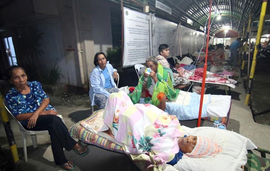 Patients spend the night outside a hospital after abandoning their rooms following a powerful earthquake that rocked Surigao city, Surigao del Norte province, in the southern Philippines, Saturday, Feb.11, 2017. Officials said, the powerful earthquake with a magnitude of 6.5, caused an undetermined number of casualties, damaged roads and buildings, including the airport, and knocked power out. (AP Photo)