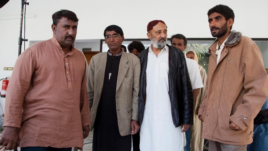 Released Pakistani fishermen arrived at the office of the International Committee of the Red Cross (ICRC) in Islamabad, Pakistan, Saturday, Feb. 11, 2017. Seven Pakistani fishermen who were jailed in Yemen for over a decade have returned home after efforts from the International Committee of the Red Cross and Pakistan's foreign affairs ministry. (AP Photo/B.K. Bangash)
