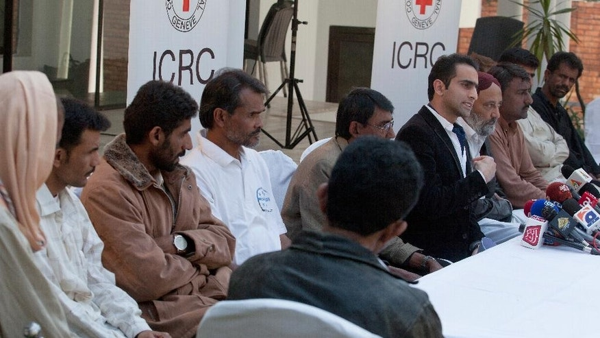 Najum Abbasi, center, official of the International Committee of the Red Cross (ICRC) briefs reporters about the released Pakistani fishermen in Islamabad, Pakistan, Saturday, Feb. 11, 2017. Seven Pakistani fishermen who were jailed in Yemen for over a decade have returned home after efforts from the International Committee of the Red Cross and Pakistan's foreign affairs ministry. (AP Photo/B.K. Bangash)
