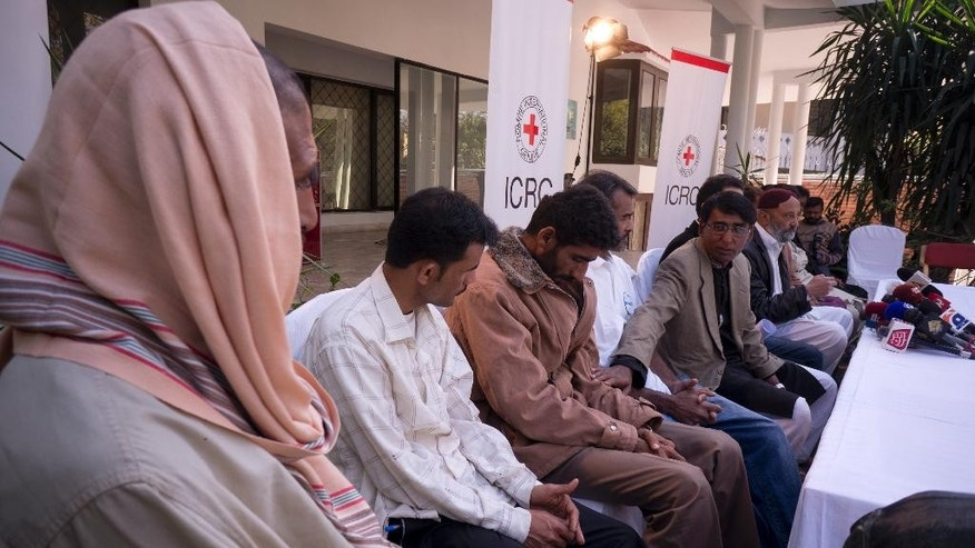 Released Pakistani fisherman Mohammad Siddique, fifth from left, introduces his colleagues to reporters during a news conference at the office of the International Committee of the Red Cross (ICRC) in Islamabad, Pakistan, Saturday, Feb. 11, 2017. Seven Pakistani fishermen who were jailed in Yemen for over a decade have returned home after efforts from the International Committee of the Red Cross and Pakistan's foreign affairs ministry. (AP Photo/B.K. Bangash)